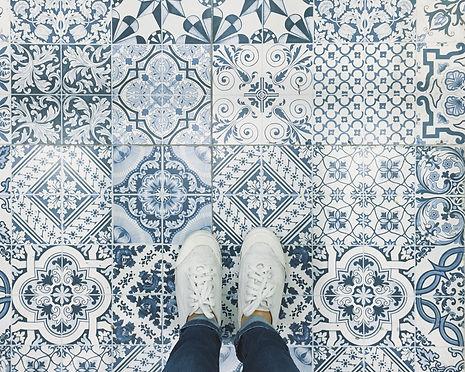 Selfie of feet with sneaker shoes on art