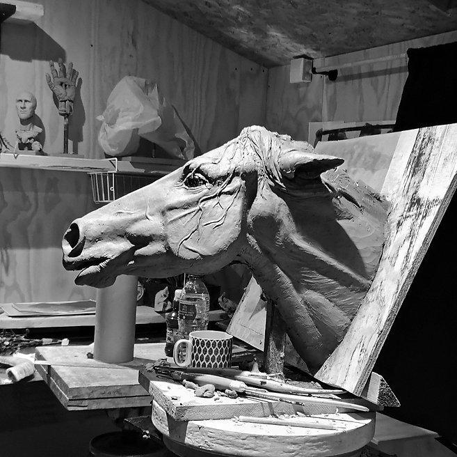 Llamrei. work in progress. the Head of a horse, straining forward, ears thrown back. Hair, spider webbed across one cheek.