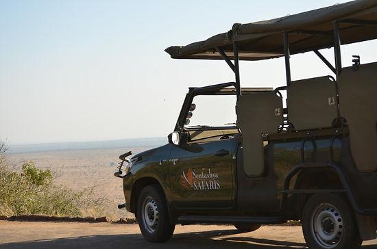 Sentashya Safaris Open Day Tour Vehicle.