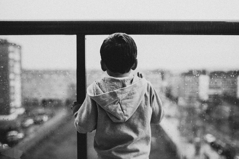 Toddler looking out of window