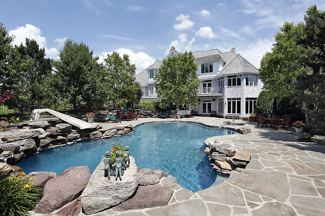 Rear view of luxury home with swimming p