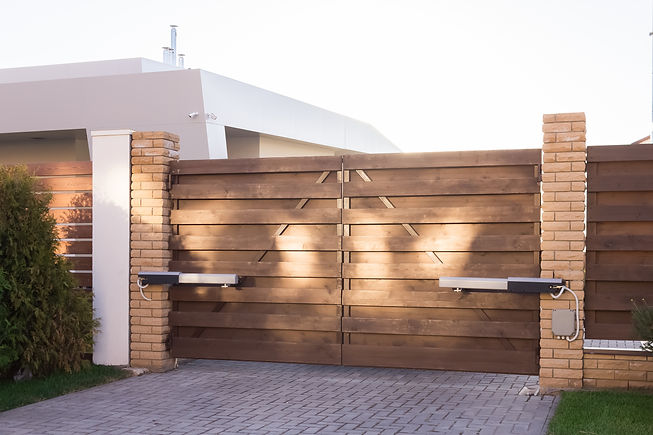 Automatic swing gates made of wood in a
