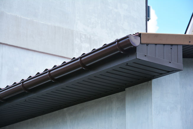 Close up on house plastic roof gutter wi