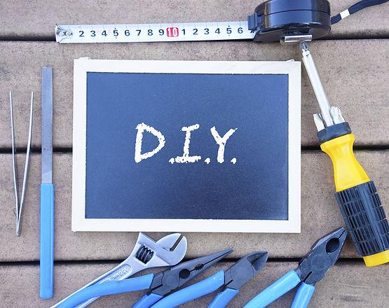 DIY(do it yourself) written on blackboar