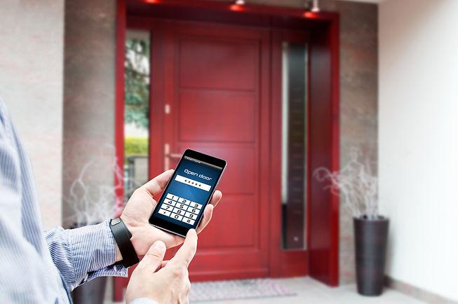 Man uses smartphone to open the door of