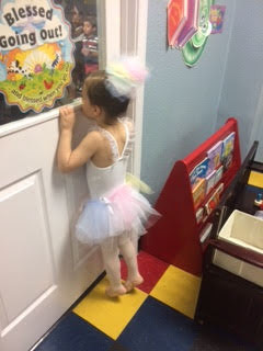 ballerina sneaking a peak at stage