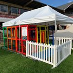 Mobile Play centre with white fence and