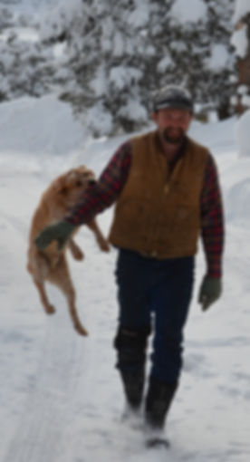 Man with jumping cattle dog.