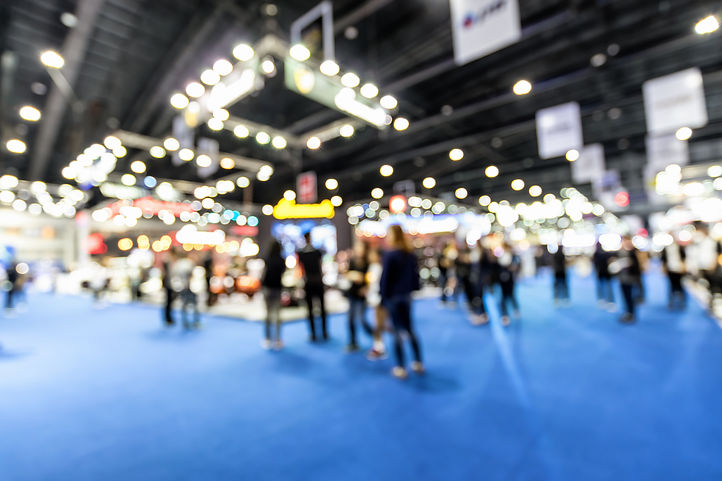Abstract blurred defocused trade event e