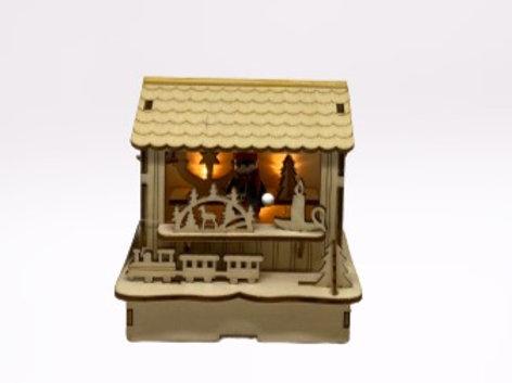 Loja de Natal em madeira com luz a pilhas