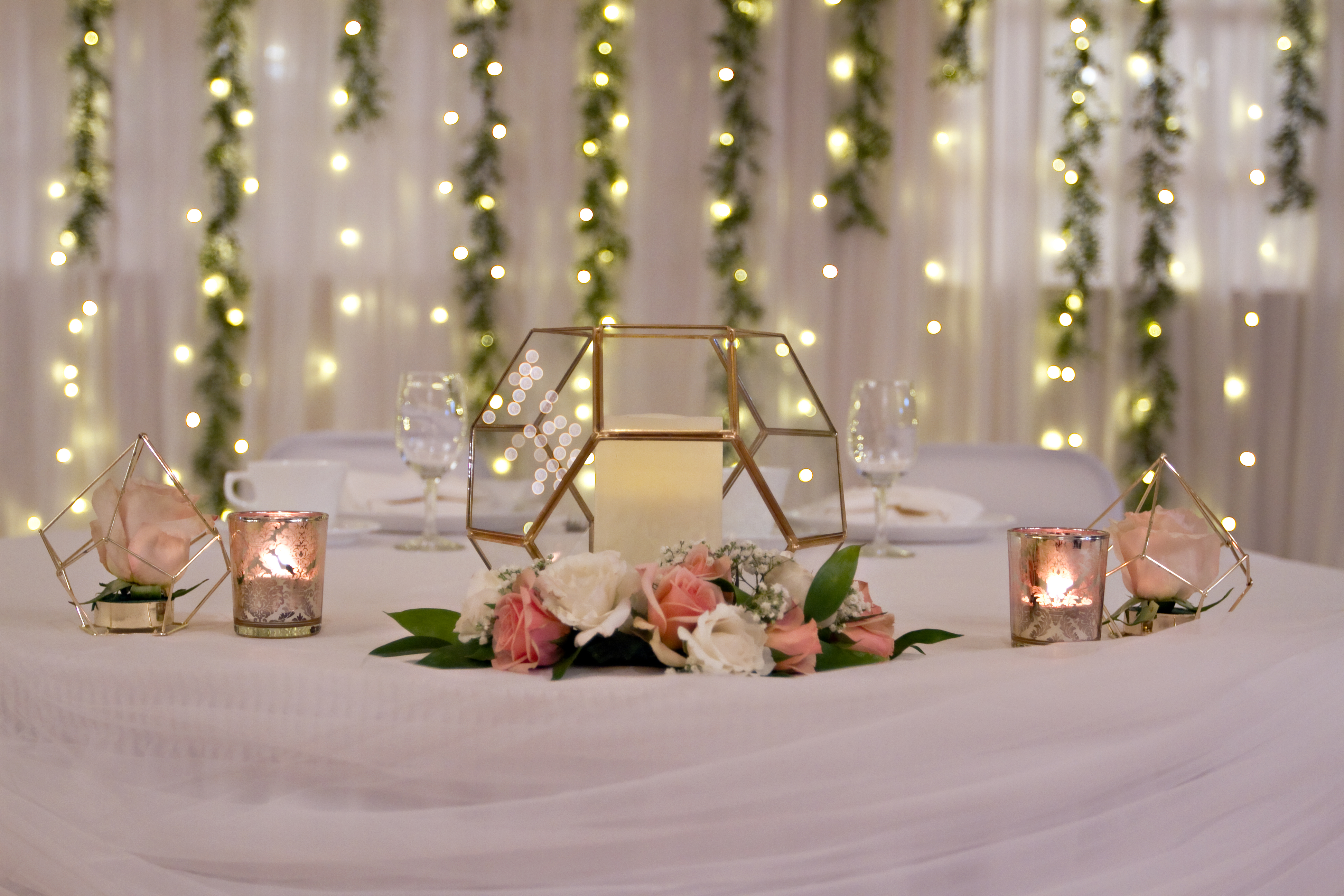 Bride's terrarium accented with Dee's rose gold votives