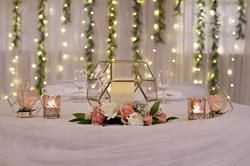 Bride's terrarium accented with Dee's rose gold votives
