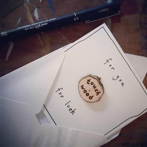 Good luck card with detachable charm