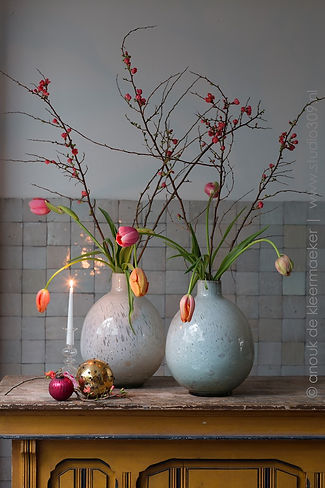 Flowers tulips quince branch candle christmas vase tile