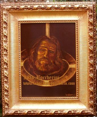 The head of St John