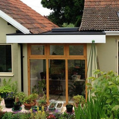 Link extension with polyurea flat roof, Bristol