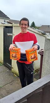 Kieran receiving his easter eggs in June