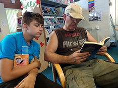 Alfie helping Dave with his reading.jpg