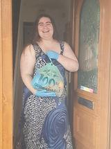Sarah receiving her food bag.jpg
