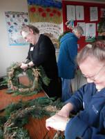 Arnold U3A members making Christmas wreaths.