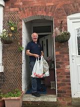 Bob Inman receiving his food bag.jpg
