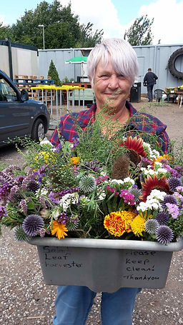 Farm Manager Anita with bunches of flowe