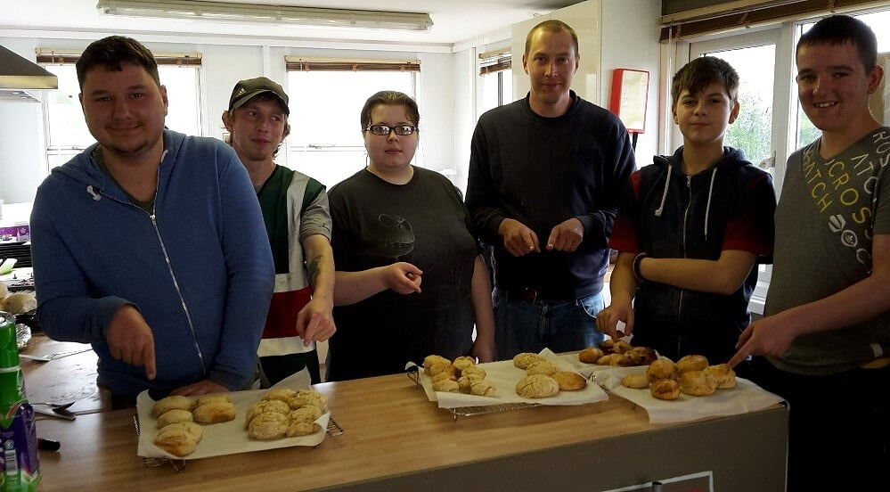 Volunteers very pleased with the biscuits they have made.