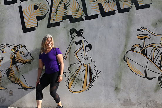 kim-k-pilates_girl-posing-by-mural