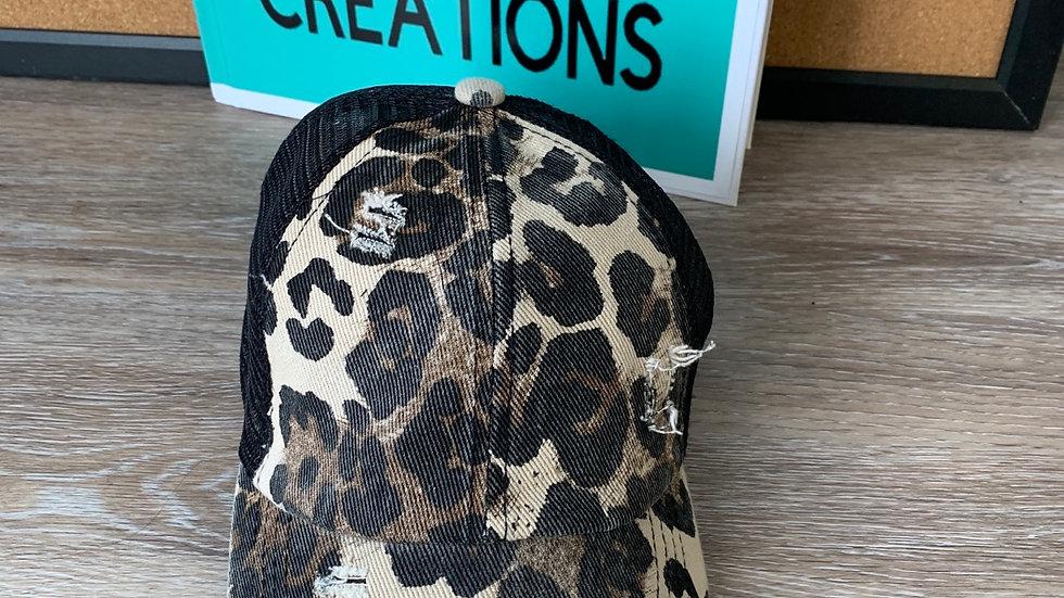 Distressed leopard ponytail hat