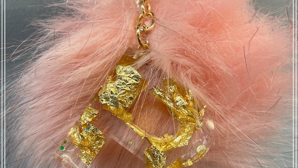 Gold glitter R with pom pom
