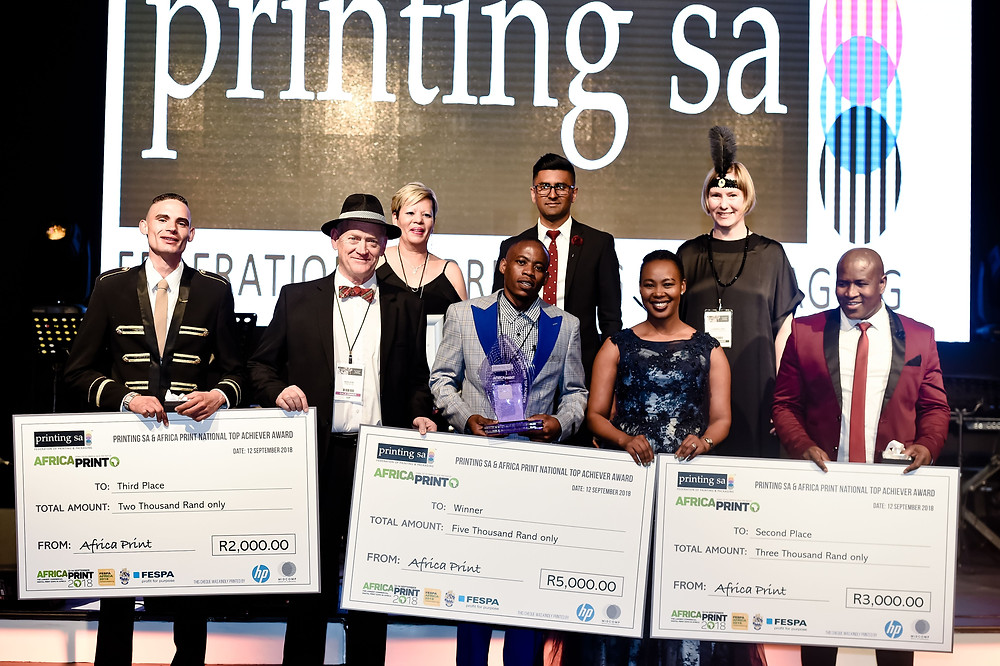 Back Row (L-R) :Charmaine Kearns (Printing SA – Central Chamber), Jermaine Naicker (Printing SA KZN Chamber) and Charnia Yapp – (Practical Publishing). Front Row (L-R): Clive Edward Sharpe, Ken Leid, Printing SA's Director of National Training and Development, Thilimbilu Tshivhase overall winner, Deputy Minister of Telecommunications and Postal Services, the Honourable Stella Ndabeni-Abrahams and Lucky Dludla