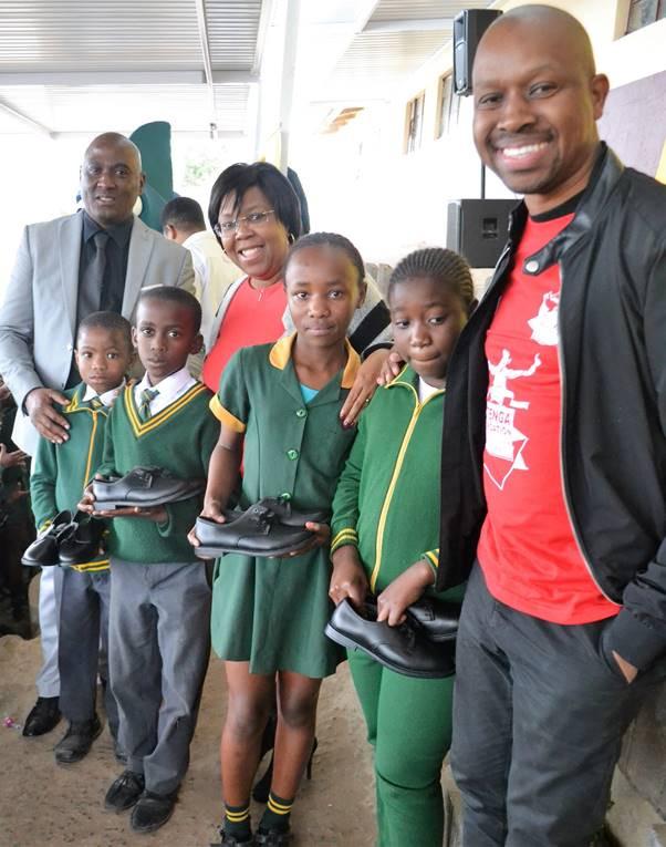 Pictured: Mr Dumisani Mvubu (Deputy principal), Dr Stella Khumalo (CEO of uShaka Marine World), Mr Siyanda Calvin Ntenga (Ntenga Foundation chairman) with some of the school children who benefitted from the new school shoes- Lulonnke Sikithi, Musawenkosi Goqo, Pamela Mbuthuma and Zonke Khoza.