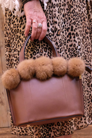 Brown bag with fluffy balls.jpg