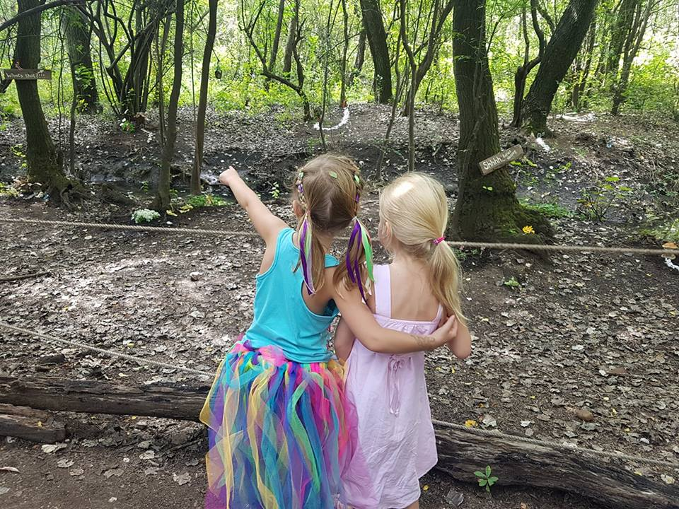 fairy trail little girls looking