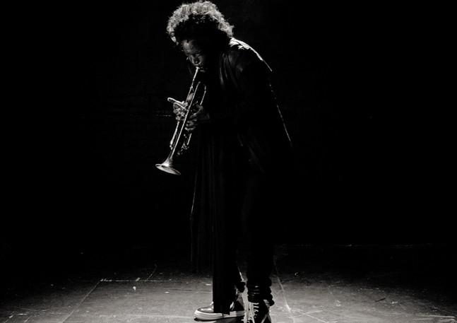 Mike Williams as Miles Davis