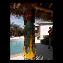 Carved and painted pole