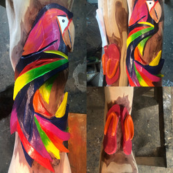 Neon parrot post carving