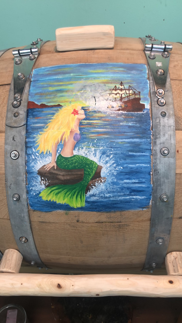 mermaid and a ship on whiskey barrrel
