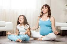 happy-pregnant-mother-kid-girl-meditatin
