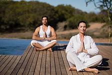couple-performing-yoga-safari-vacation (