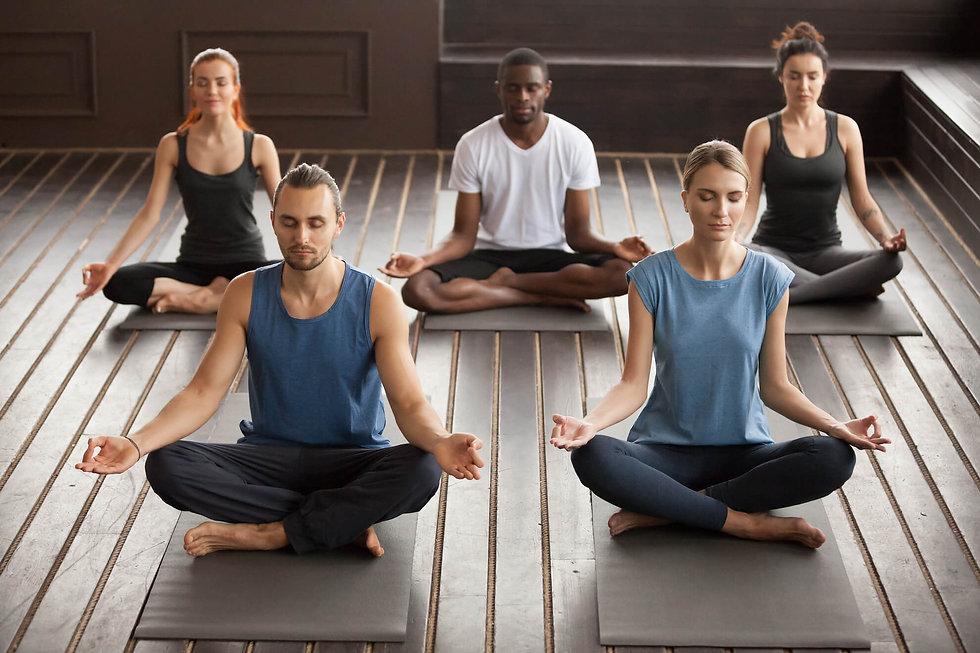 group-young-yogi-people-sitting-sukhasan