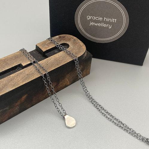 Silver mini price tag pendant on oxidised silver chain