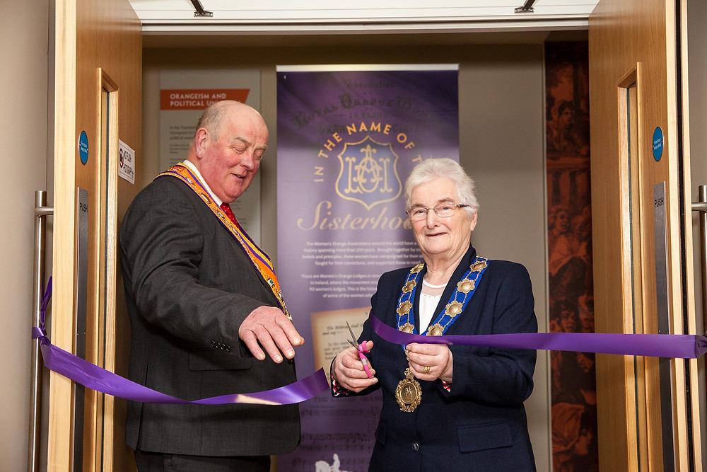 Grand Master of the Grand Orange Lodge of Ireland, Edward Stevenson, helps the Grand Mistress of the Association of Loyal Orangewomen of Ireland, Joan Beggs, to officially cut the ribbon to open the 'In the Name of the Sisterhood' exhibition at Schomberg House. Pictures: Graham Balhaam-Curry
