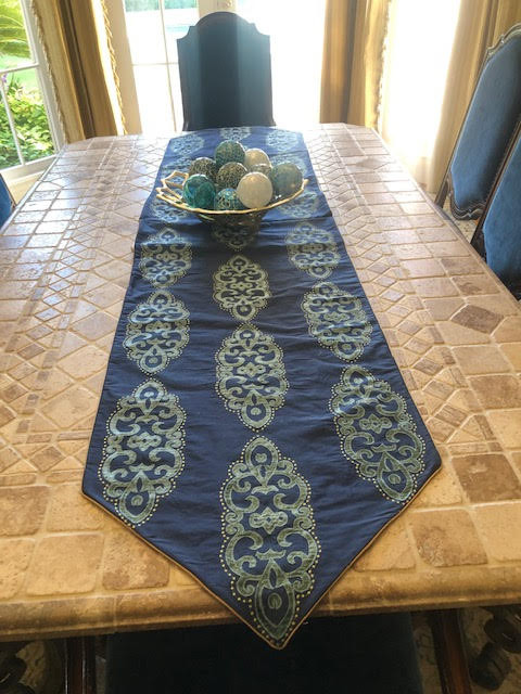 Elegant embroidered silk table runner is interlined and micro- corded.