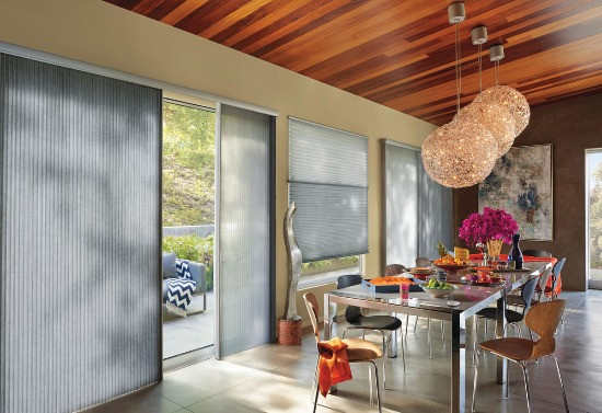 Dining area with Hunter Douglas Vertiglide and Duette shades.