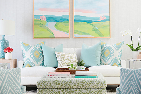 Colorful throw pillows on a  neutral sofa