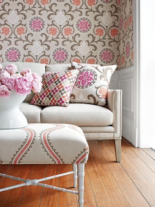 Coordinating fabrics on sofa and ottomon.