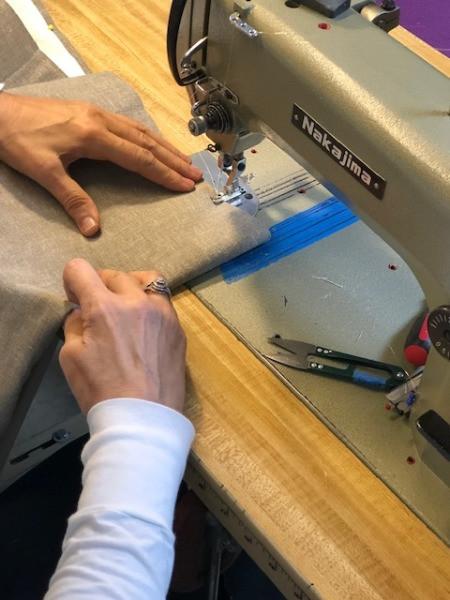 Seamstress sewing pleats