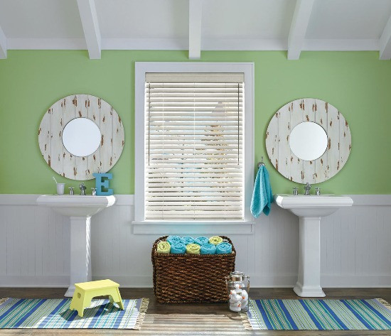 Bathroom with wood blinds.
