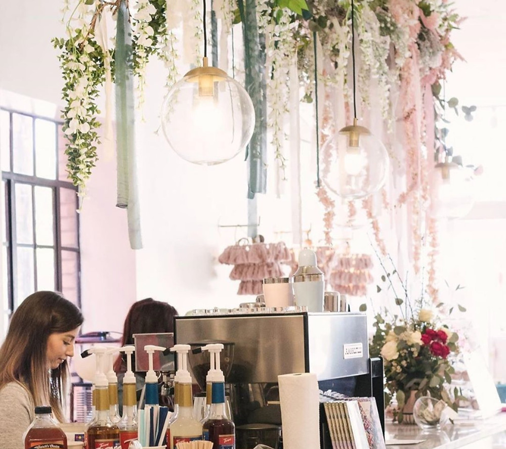 pink coffee shop with pink ombre floral over the bar
